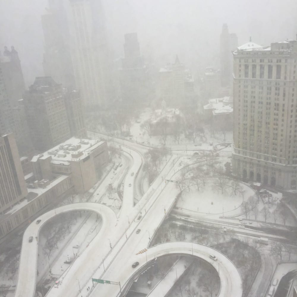 Winter Storm Jonas pelts Lower Manhattan with blizzard conditions on January 23, 2016. Photo from the Intergate.Manhattan high-rise data center shows approach and exit ramps to the Brooklyn Bridge, with City Hall at upper center. A city-wide motor vehicle travel ban was imposed just hours later. Credit: Sabey Data Centers