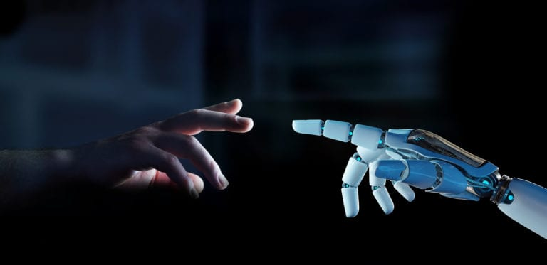Image: human hand reaching out to robot hand
